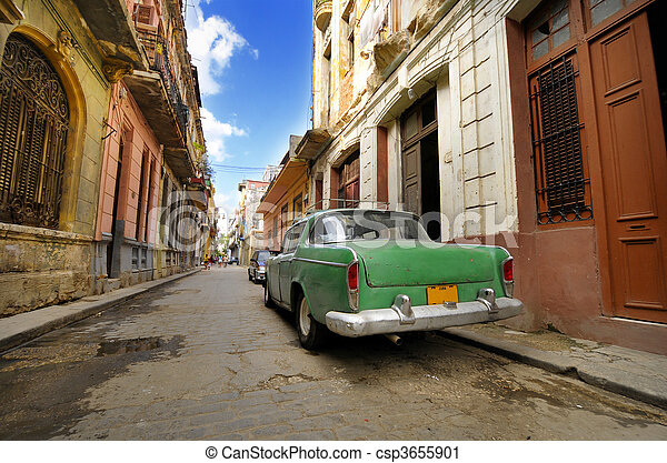 Old car in shabby Havana street, cuba - csp3655901