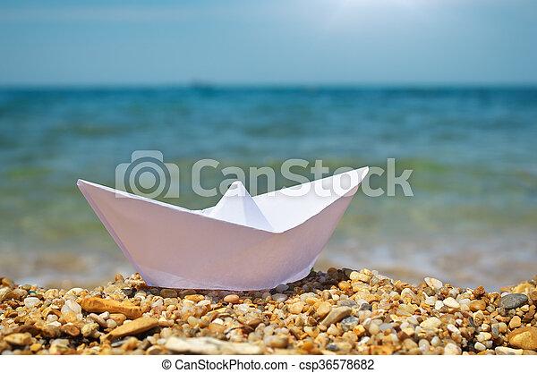 Origami ship on the sea. - csp36578682