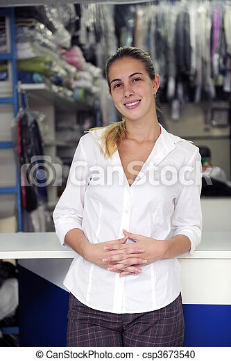 happy owner of a dry cleaning business - csp3673540