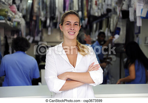 happy owner of a dry cleaning business - csp3673599