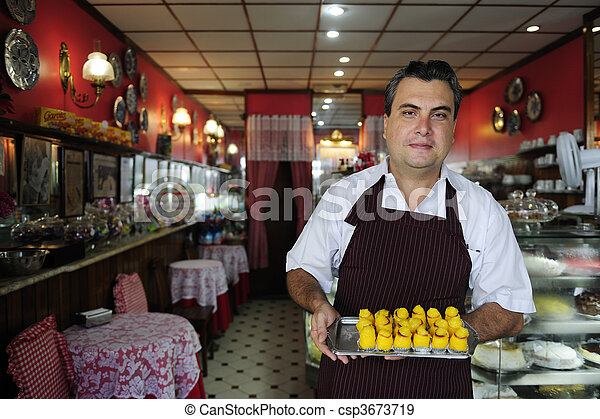small business: owner of a cafe showing  tasty pastry - csp3673719