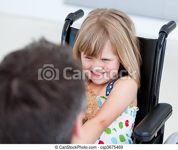 Reserved little girl sitting on the wheelchair - csp3675469
