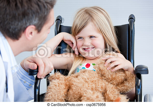 Laughing little girl sitting on the wheelchair - csp3675956