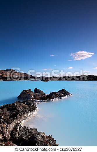 Milky white and blue water of the Blue Lagoon geothermal baths in Iceland - csp3676327