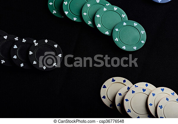 gamble colour chips lay on black table