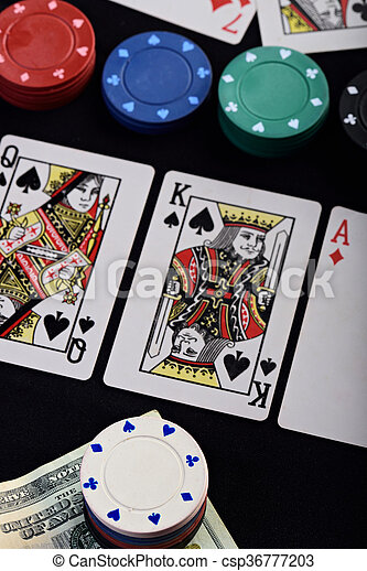 gamble game with chips and cards on black table