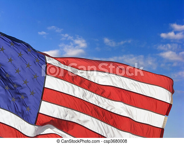 American flag flying proudly on a windy day - csp3680008