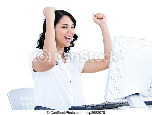 Positive businesswoman punching the air in front of her computer in the office - csp3682070