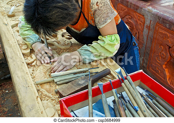 Wood carver at work in Xi\'an, China - csp3684999