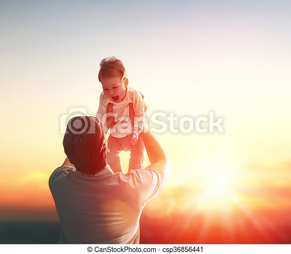 Happy loving family. Father and his daughter baby girl playing and hugging outdoors. Concept of Father\'s day.