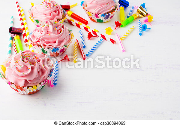 Birthday background with pink cupcakes. Birthday cupcakes. Homemade cupcake. Gourmet cupcakes. Sweet dessert. Sweet pastry. Birthday invitation. Birthday mockup. Styled desktop. Birthday background.