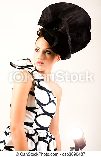 Young Woman in Haute Couture Attire - Isolated - csp3690487