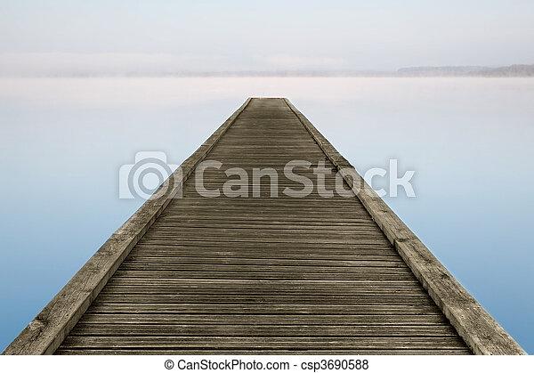 Zen jetty on foggy lake