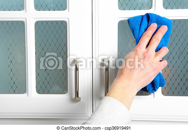 Woman hand doing chores in the kitchen at home , cleaning kitchen dresser