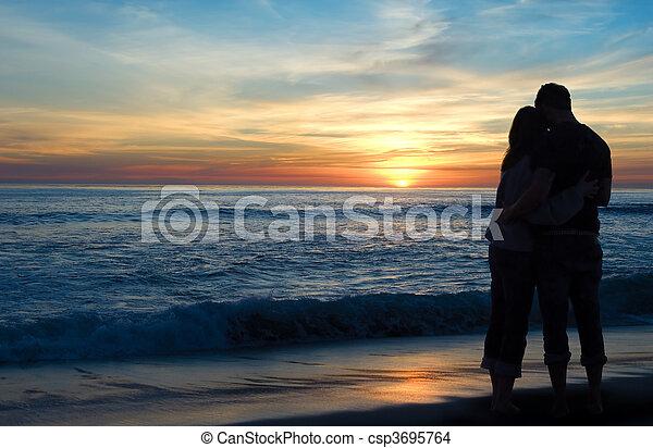 Couple Watching Sunset - csp3695764