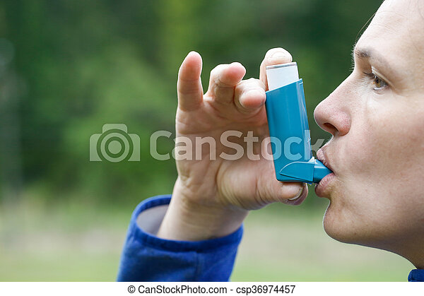 Asthma patient inhaling medication - csp36974457