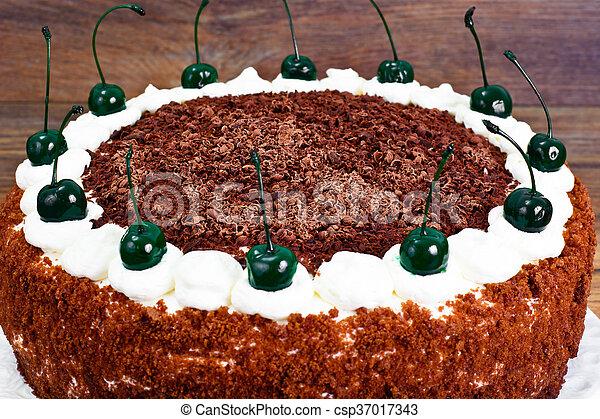 Schwarzwald Cake, Whipped Cream, Black and White Chocolate, Decoration, Green Cocktail Cherry Studio Photo