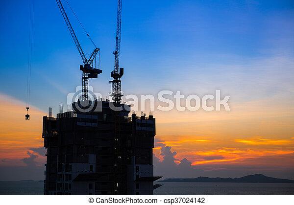 construction near the beach at sunset - csp37024142