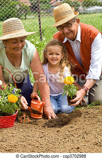 Grandparents teaching little girl the ways of gardening - csp3702988