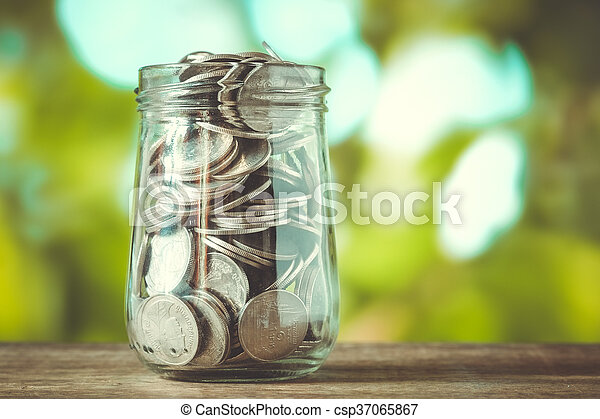 save money for investment concept money in the glass with filter effect retro vintage styl