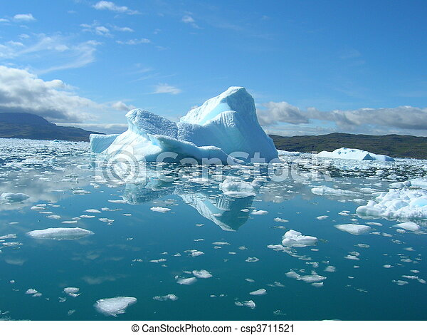 Melting icebergs by the coast of Greenland, on a beautiful summer day. - csp3711521