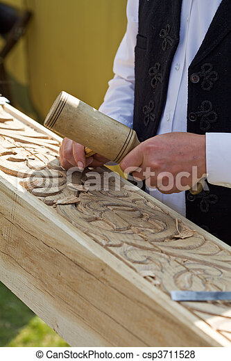 Traditional craftsman carving wood - csp3711528