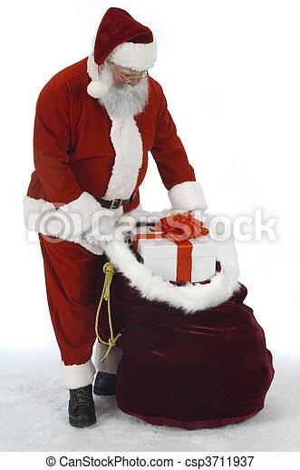 Santa Opening Sack of Toys - csp3711937