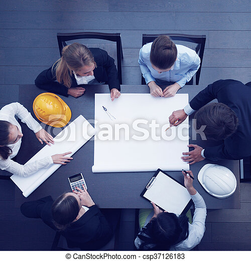 Top view of people around table in construction business meeting