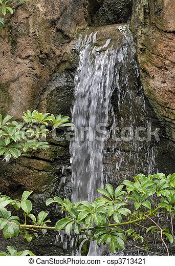 beautiful waterfall in garden - csp3713421