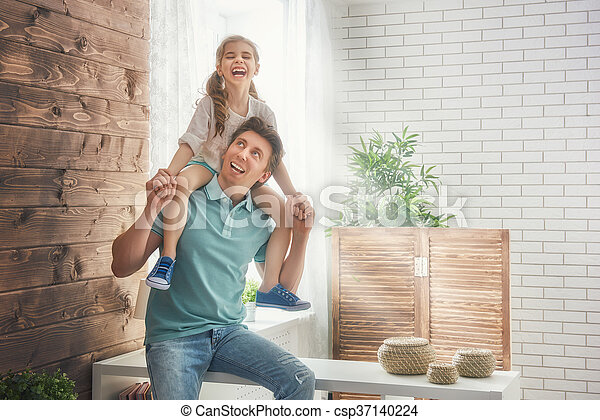 Happy loving family. Father and his daughter child girl playing together. Father\'s day concept.
