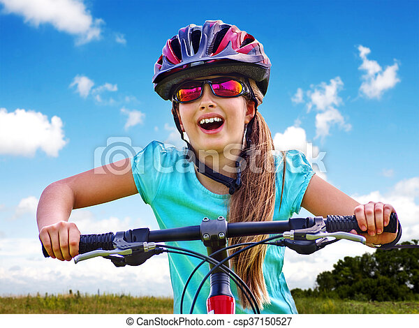 Bikes cycling girl wearing helmet rides bicycle.