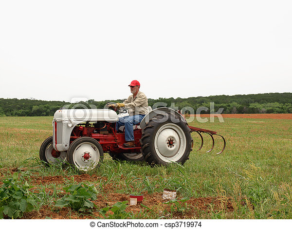 Stock Photo of Farmer on his old time tractor - Farmer ...