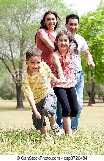 Happy family having fun in the park - csp3720484
