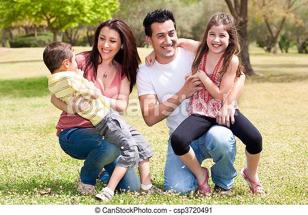 Happy family enjoying in the park - csp3720491
