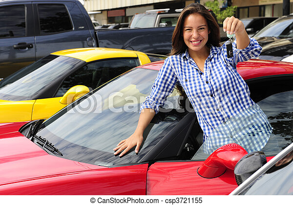woman showing key of new sports car - csp3721155
