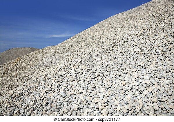 gravel gray mound quarry stock blue sky