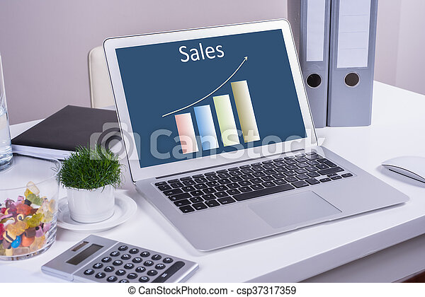Sales performance chart on computer on desk