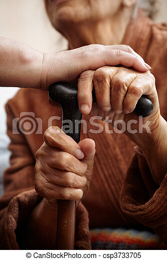 adult helping senior in hospital - csp3733705