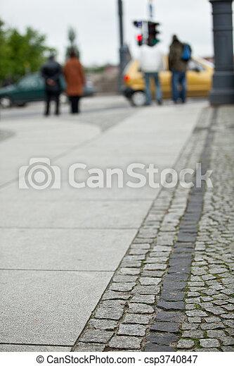 Pedestrians crossing a street of big city - csp3740847