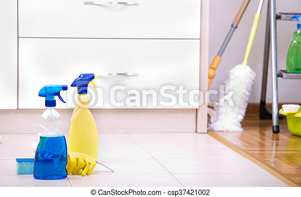 Cleaning supplies and equipment on the tiled floor in the kitchen