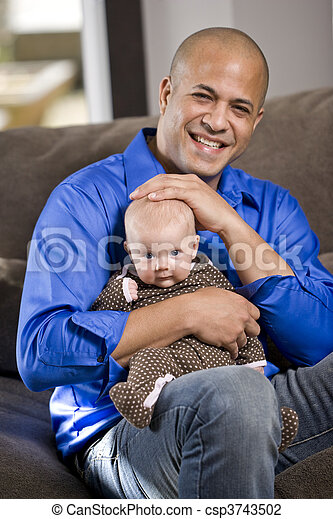Happy dad with baby sitting on lap - csp3743502