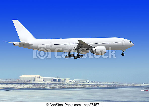 airplane is landing to runway - csp3745711