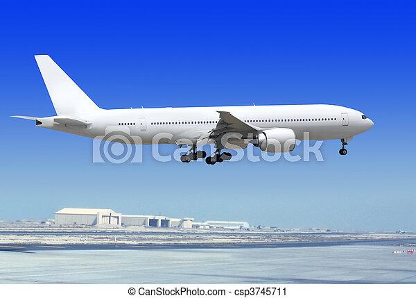 airplane is landing to runway - csp3745711