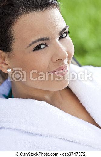 Beautiful Hispanic Woman in White Bathrobe At Health Spa - csp3747572