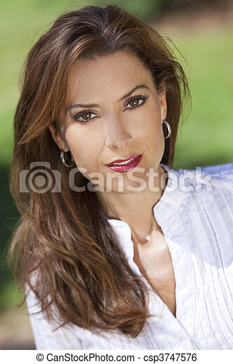 Outdoor Portrait of A Beautiful Young Woman In Her Thirties - csp3747576