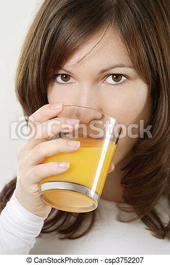 Drinking orange juice - csp3752207