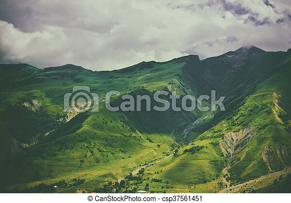 Green caucasus mountain landscape in Georgia, natural travel vintage hipster vacation background