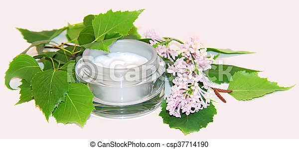 jar natural cream sprig bloom purple white lilac cosmetic set isolated on grey background. Feminine, beauty and cosmetics concept