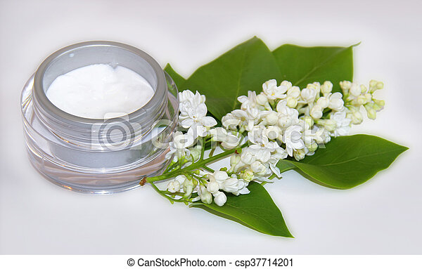 jar natural cream sprig bloom white lilac cosmetic set isolated on grey background. Feminine, beauty and cosmetics concept