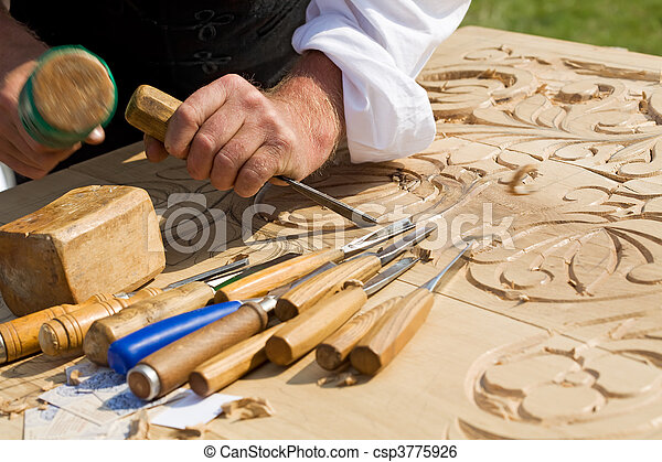 Traditional craftsman carving wood - csp3775926
